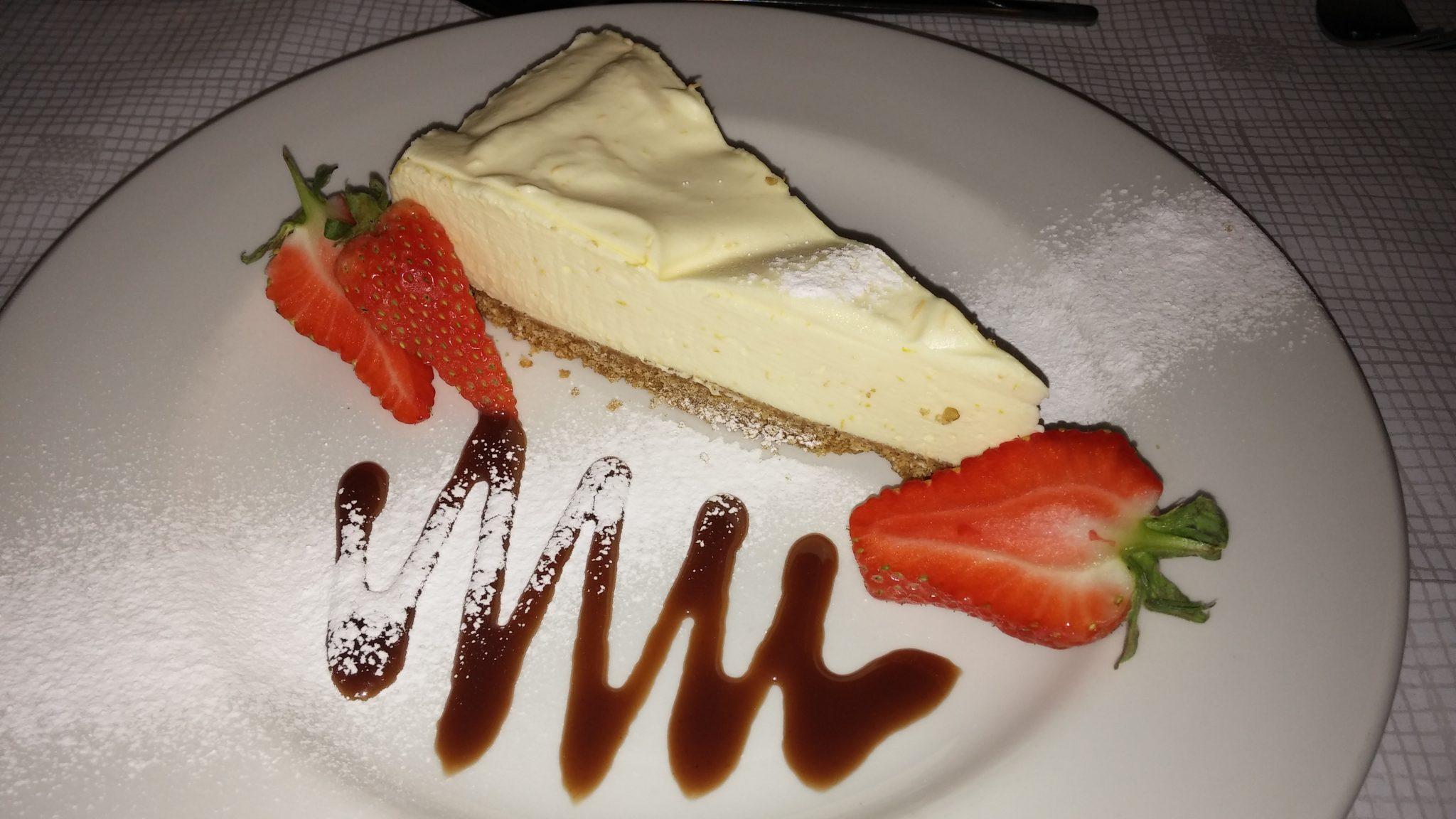 Orange home-made cheesecake & chocolate sauce