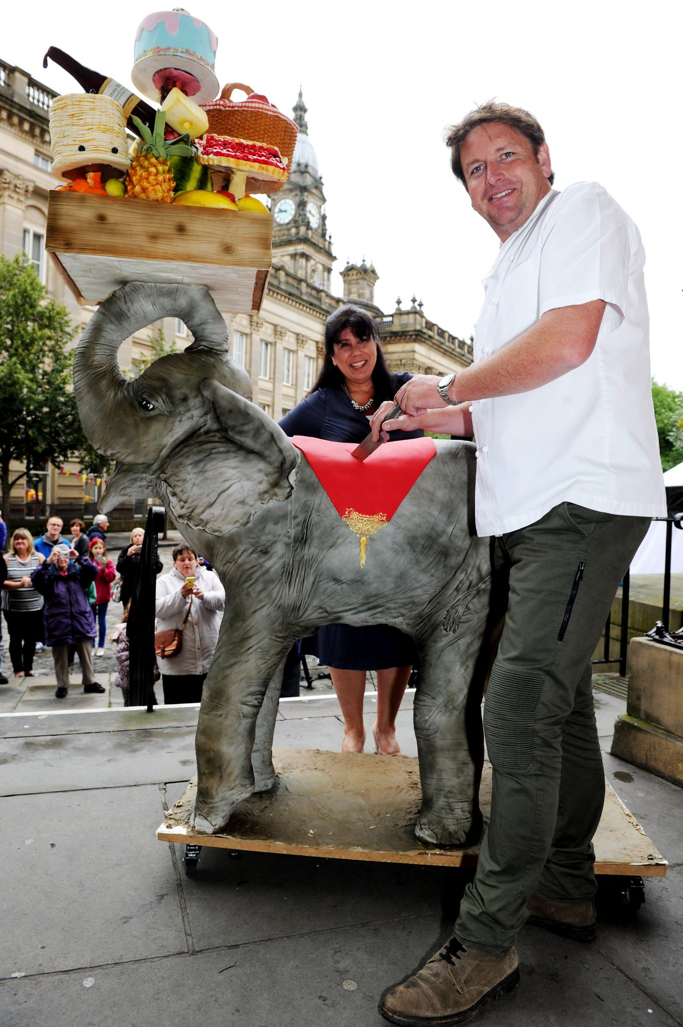The 10th annual Bolton Food and Drink Festival, Victoria Square, Bolton, Lancashire. Celebrity chef James Martin cuts into the 10th anniversary cake with maker Rosie Dummer. Picture by Paul Heyes, Monday August 31, 2015.