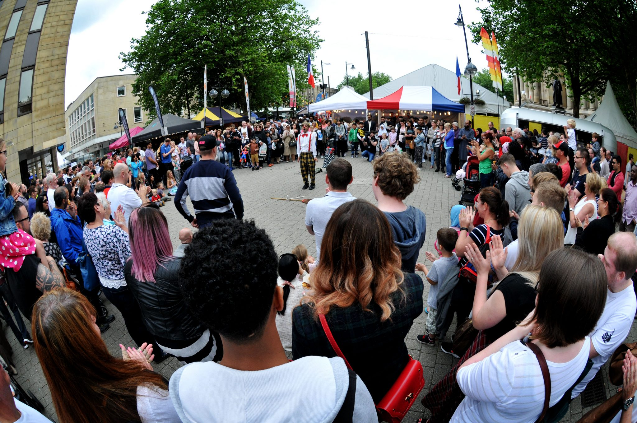 The 10th annual Bolton Food and Drink Festival, Victoria Square, Bolton, Lancashire. Street entertainer Pedro Tochas attracts a large crowd. Picture by Paul Heyes, Sunday August 30, 2015.