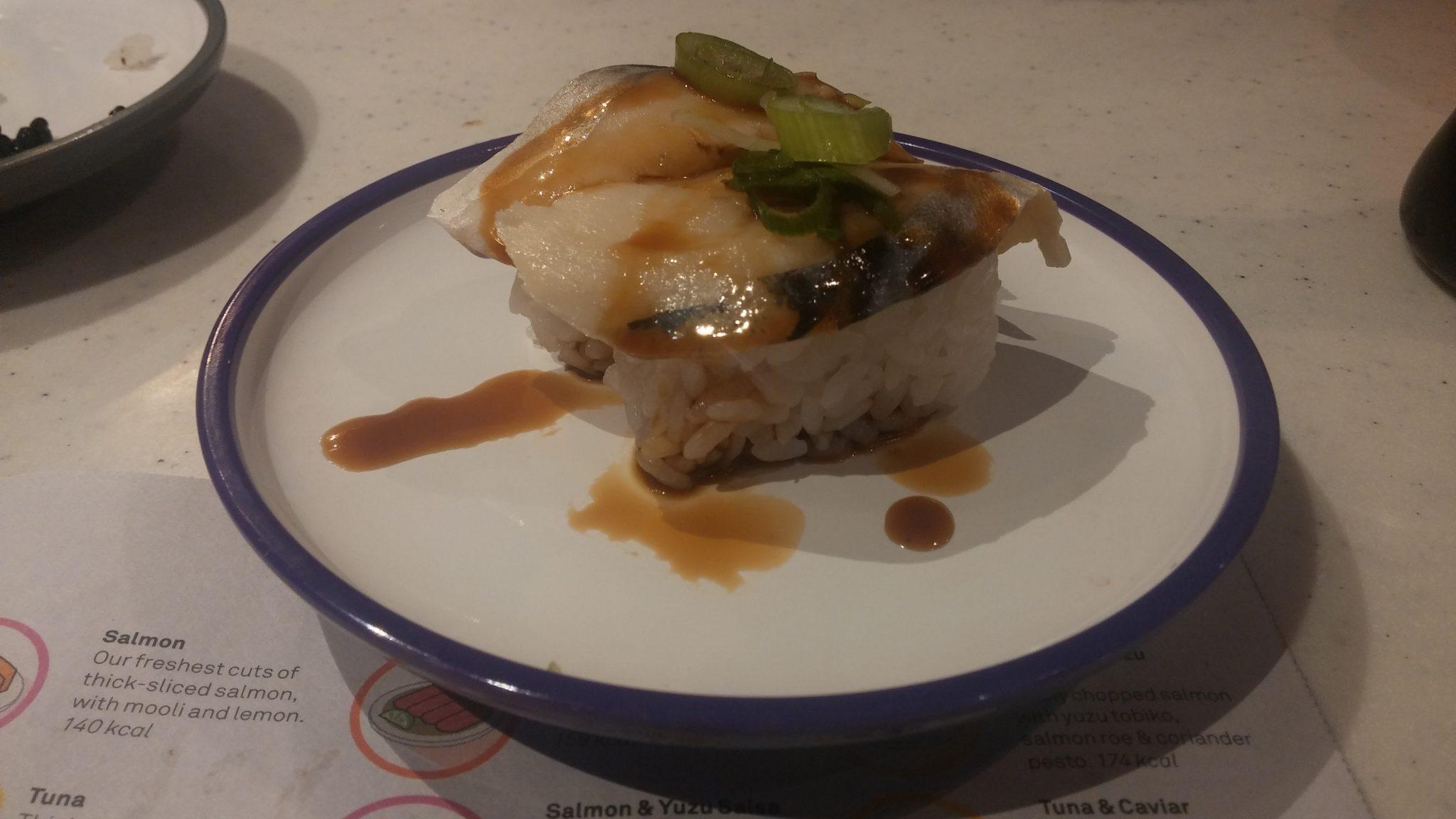 Teriyaki glazed cured mackerel slices, spring onion
