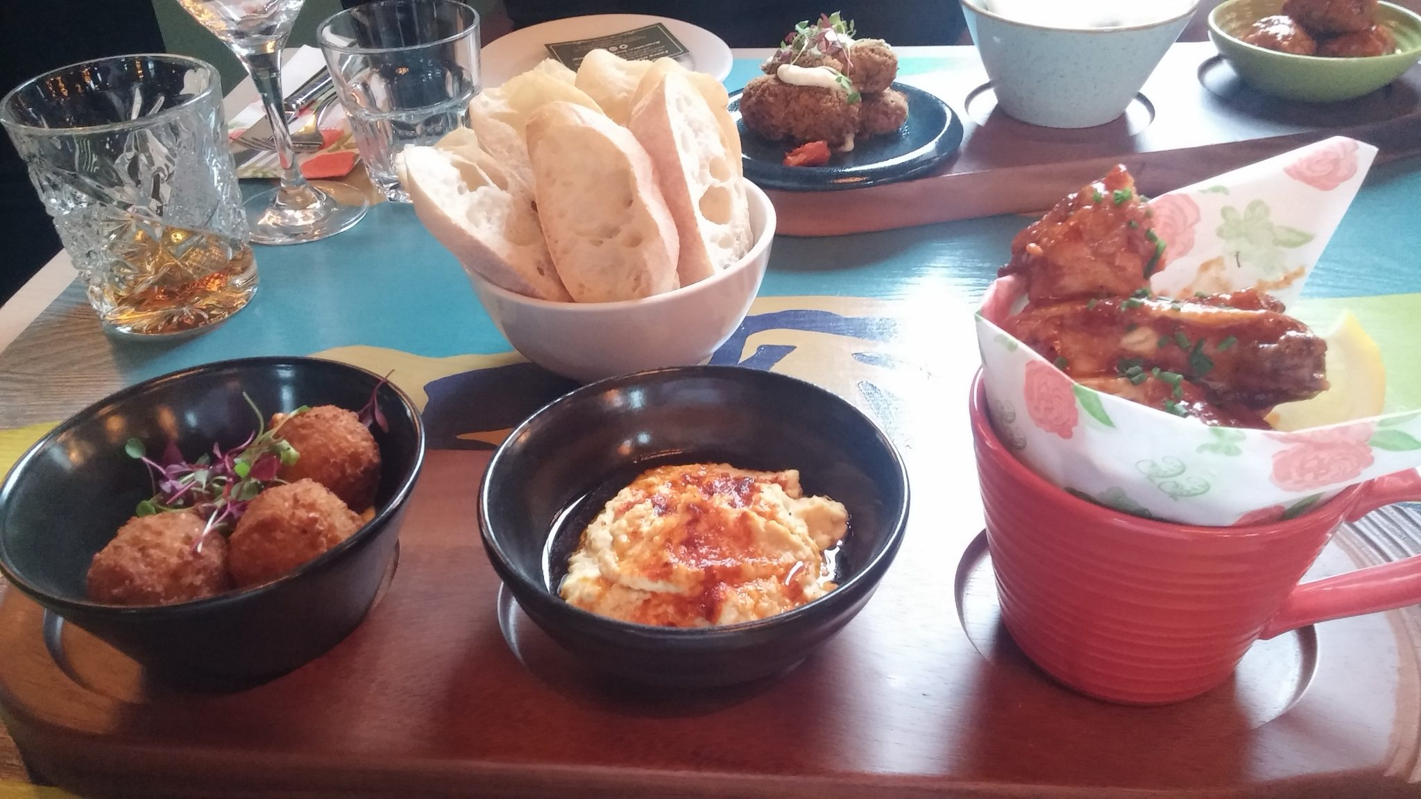 (left to right: falafels, hummus, chicken wings)