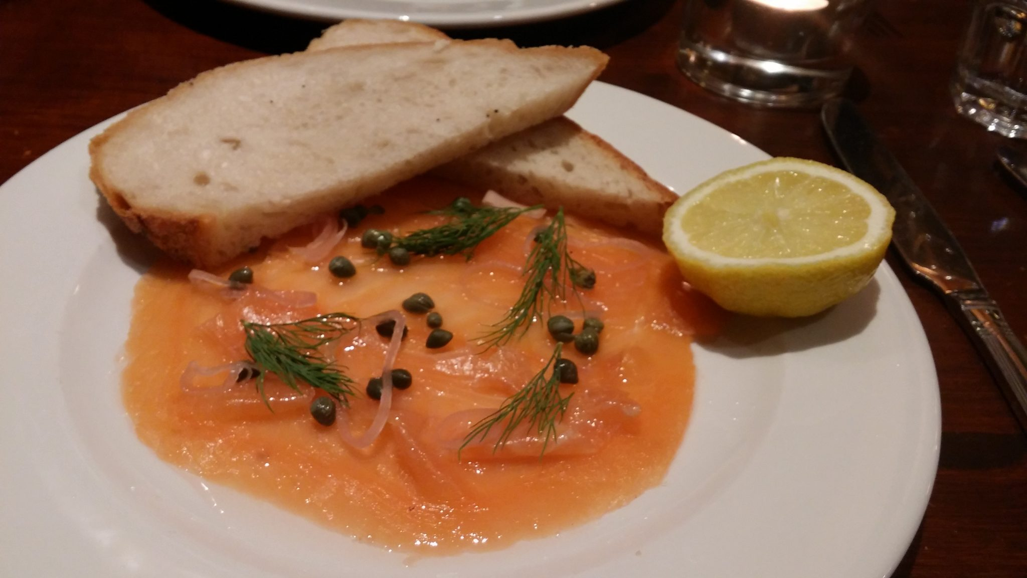 H. Foreman & Sons Scottish Smoked Salmon (with shallots, Lilliput capers, lemon), slice of sourdough.