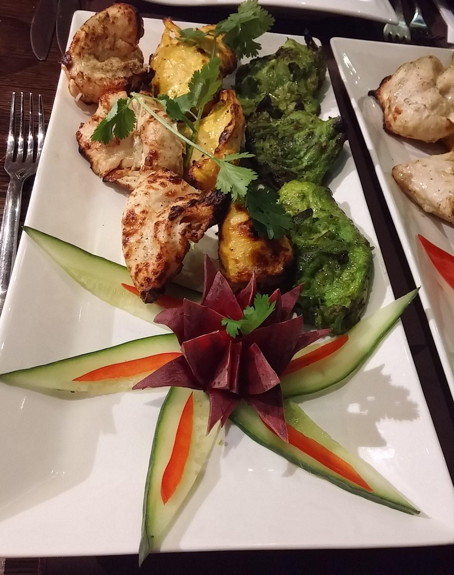 Appetisers of taranga chicken tikka in Indian flag colour: Green: hari chicken tikka (coriander, mint, chilli marinade) White: kaali mirch (black pepper, lychee marinade) Yellow: kesari murgj (saffron infused)