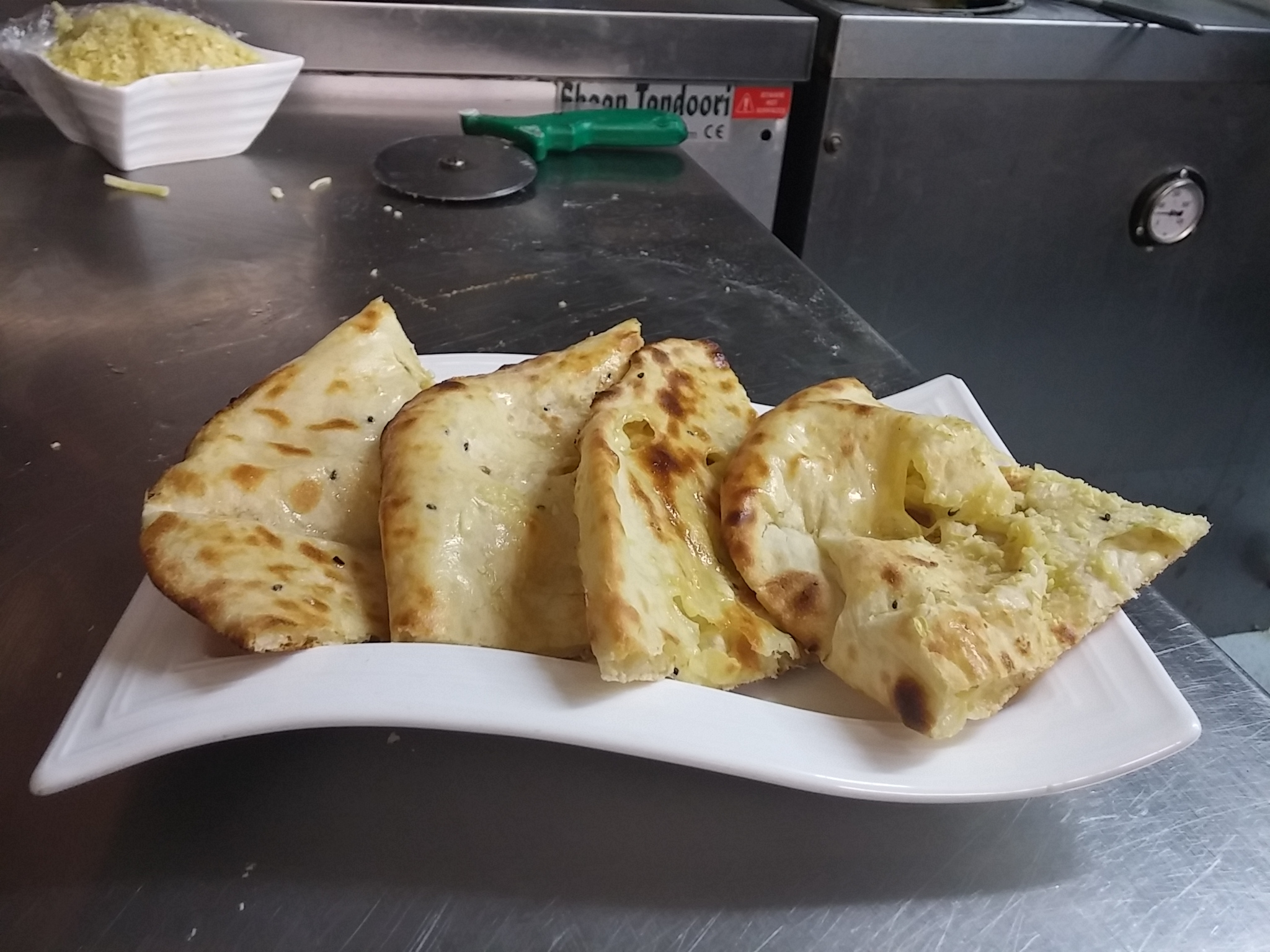 Hot from the tandoor, cheese and garlic naan cooked by the thoroughly fabulous Mr Singh himself