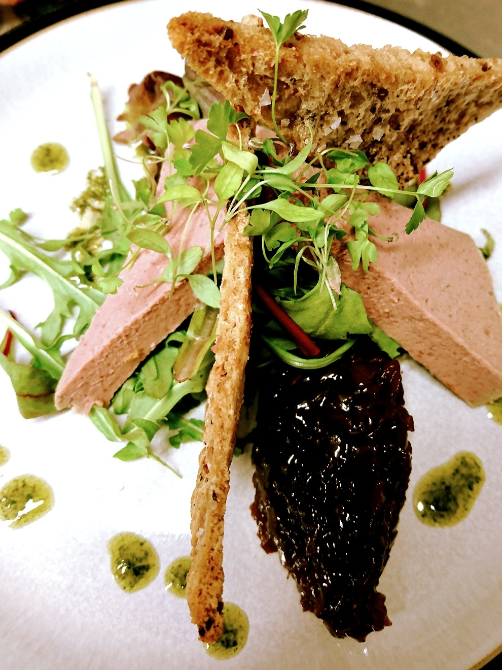 Chicken & duck liver parfait on bed of rocket, red onion marmalade basil oil, homemade rye wafers