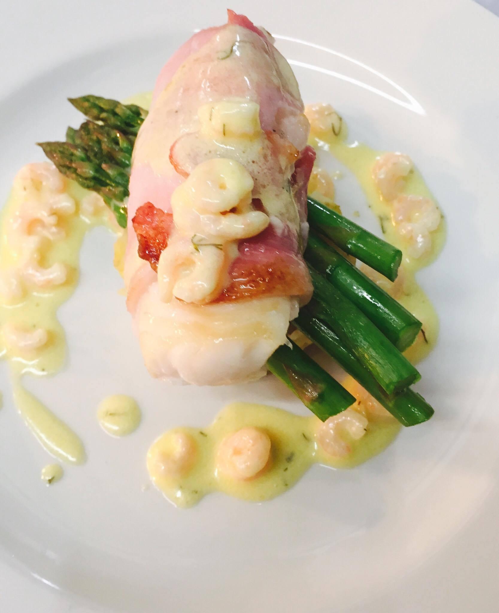 Back wrapped cod lion, crushed new potatoes, British asparagus and prawn, lemon cream.