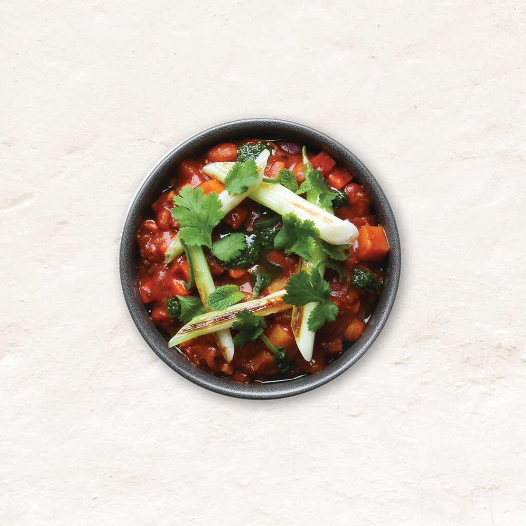 Vegan chipotle five bean estofado